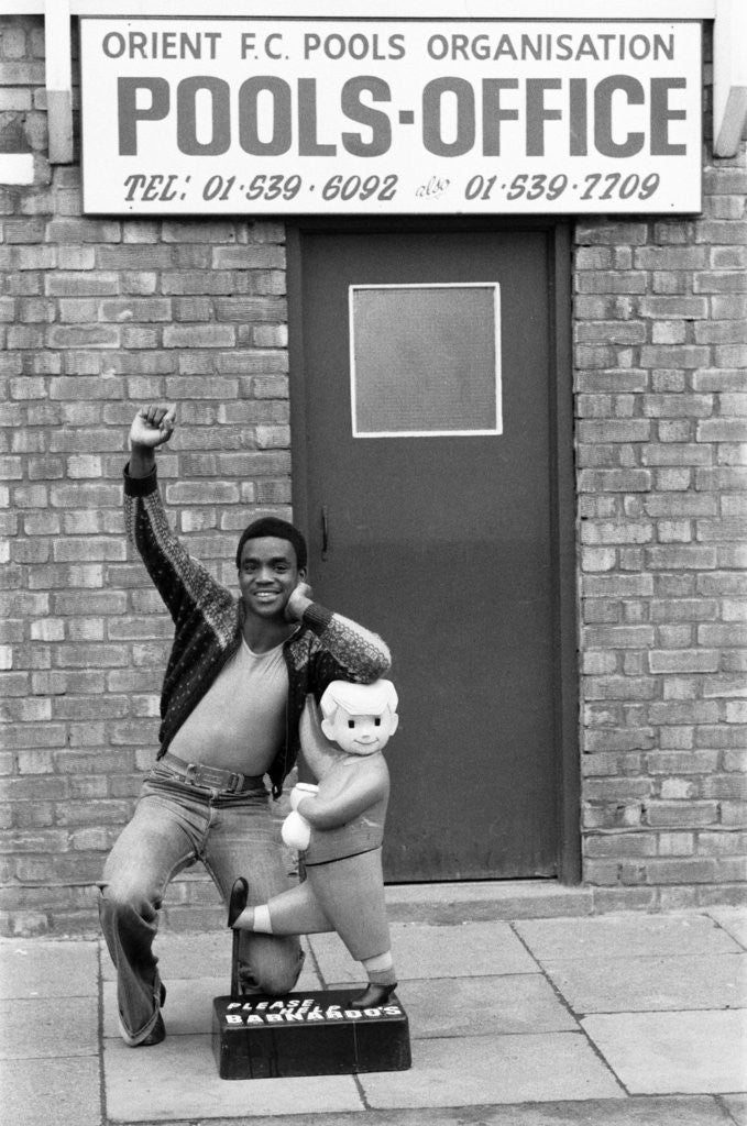Detail of Laurie Cunningham outside Leyton Orient Football Club Pools Office. by Monte Fresco