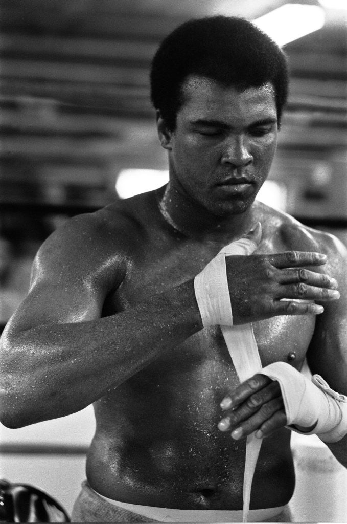 Detail of Muhammad Ali wrappings his hands by Staff
