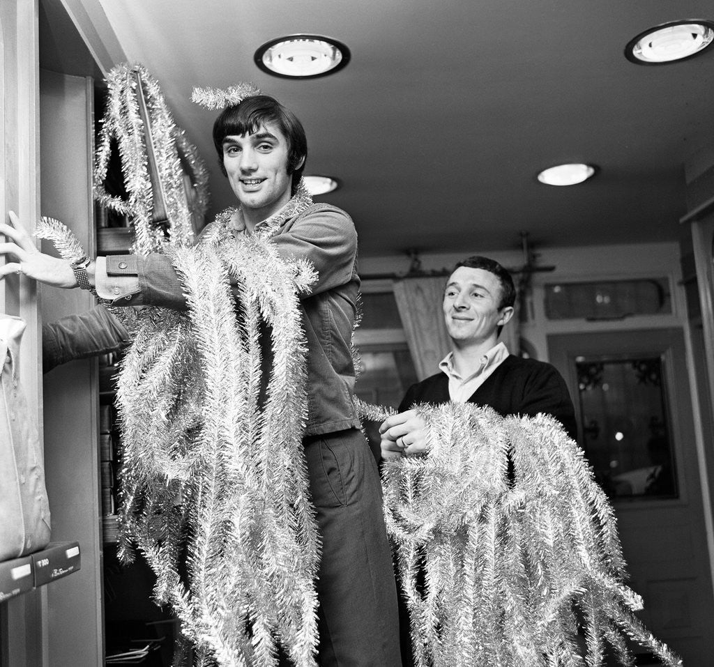 Detail of George Best decorating his Edwardian boutique 1967 by Staff
