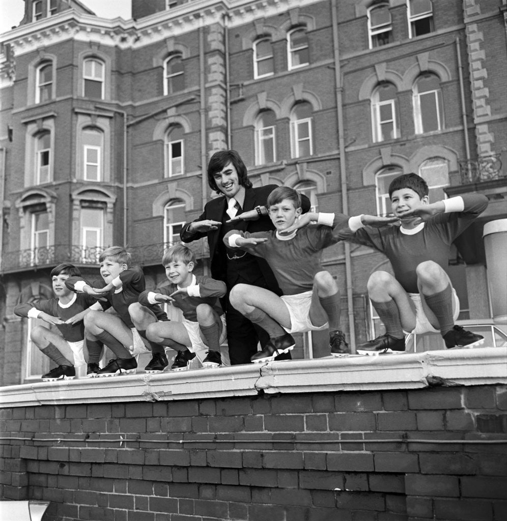 Detail of George Best with kids, Blackpool, 1970 by Staff