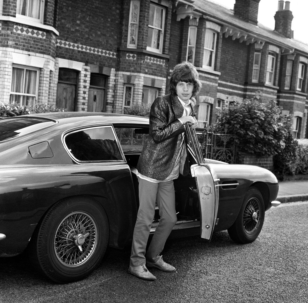 Mick Jagger With An Aston Martin Posters & Prints By Unknown