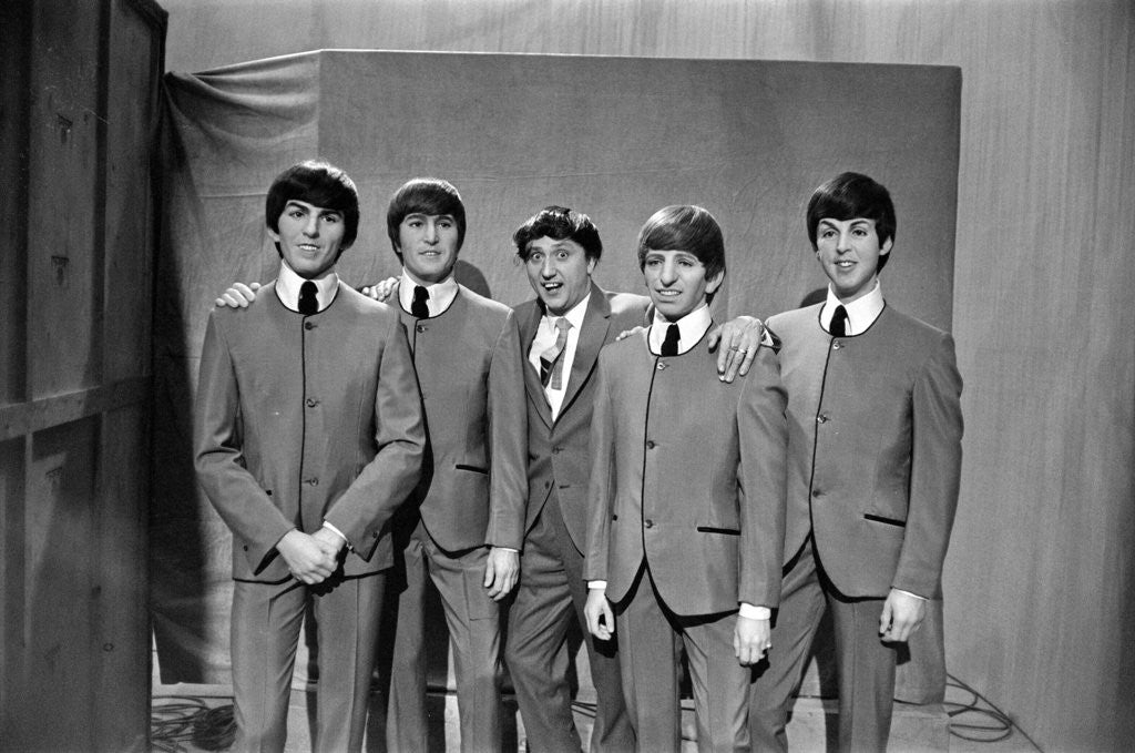Detail of Ken Dodd (centre) posing with Madame Tussauds figures of The Beatles. Picture taken on the set of Juke Box Jury, that Ken Dodd is filming. by Staff