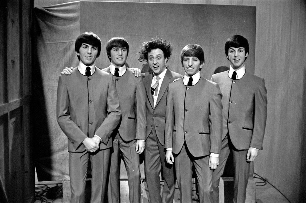 Detail of Ken Dodd posing with Madame Tussauds figures of The Beatles by Unknown