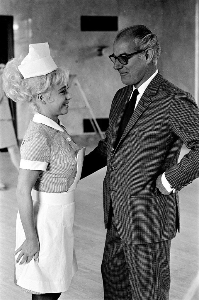 Detail of Barbara Windsor and producer Peter Rogers on the film set of Carry On Doctor. by Staff