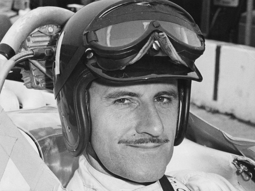 Detail of Graham Hill in cockpit of Lola T90 by Anonymous