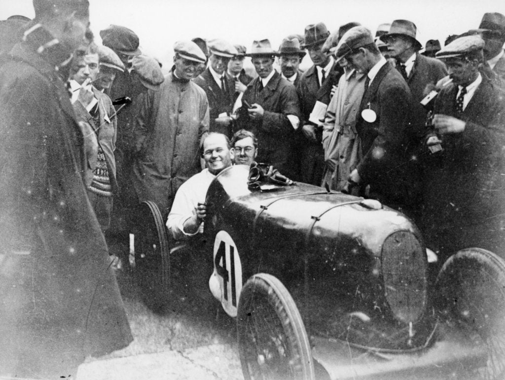 Detail of Gordon Taylor in a racing car surrounded by a crowd of men by Unknown