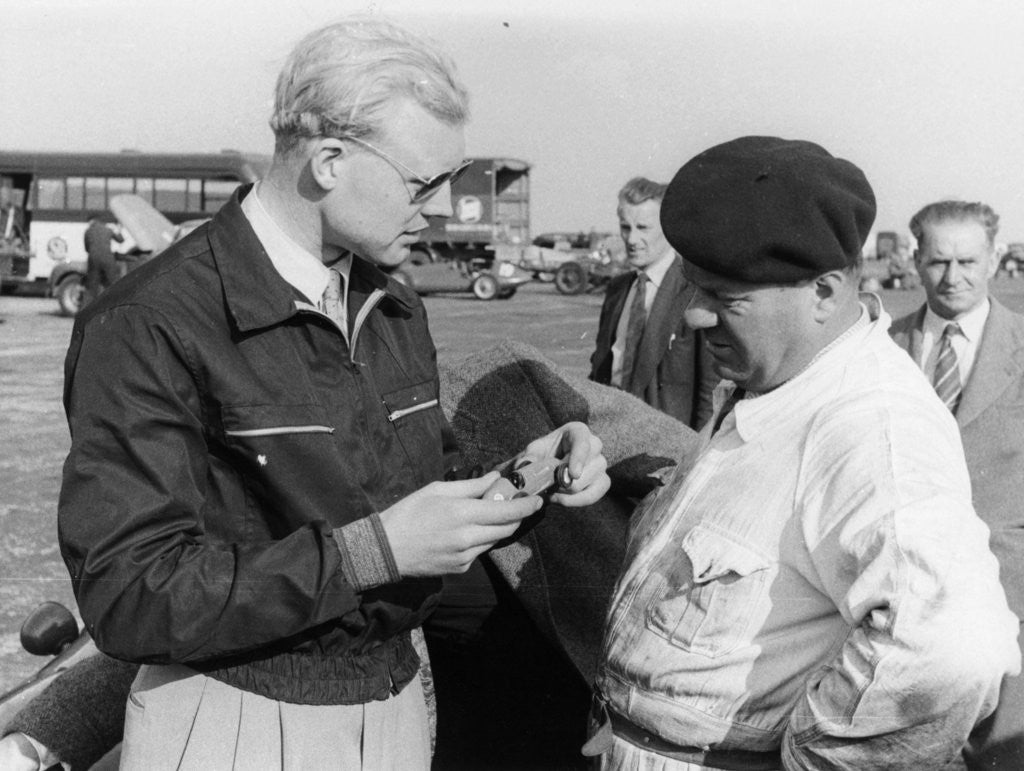 Detail of Mike Hawthorn with a model car by Anonymous