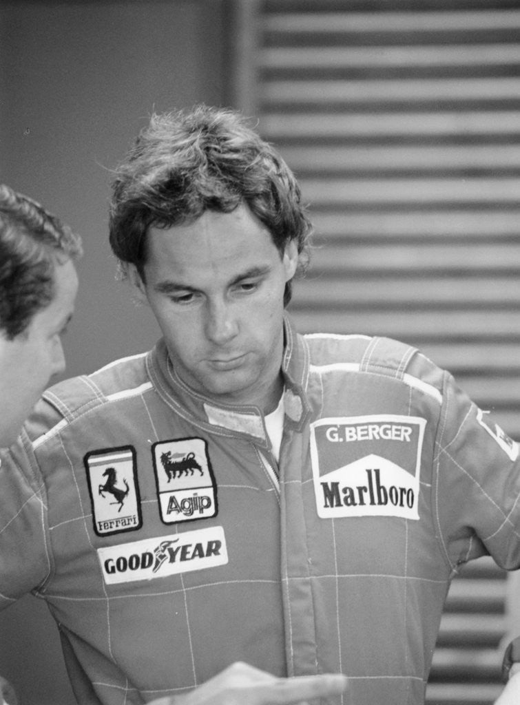Detail of Gehard Berger listening to a member of the Ferrari team by Anonymous