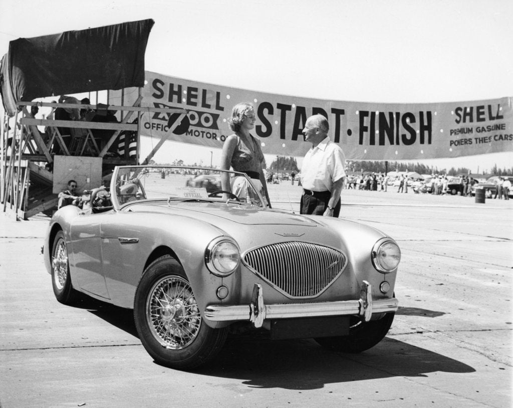 Detail of Donald Healey with an Austin Healey at a motor race by Unknown