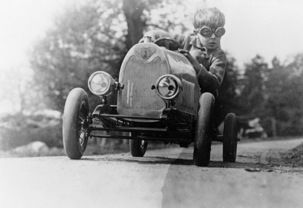Detail of Boy in a pedal car by Unknown