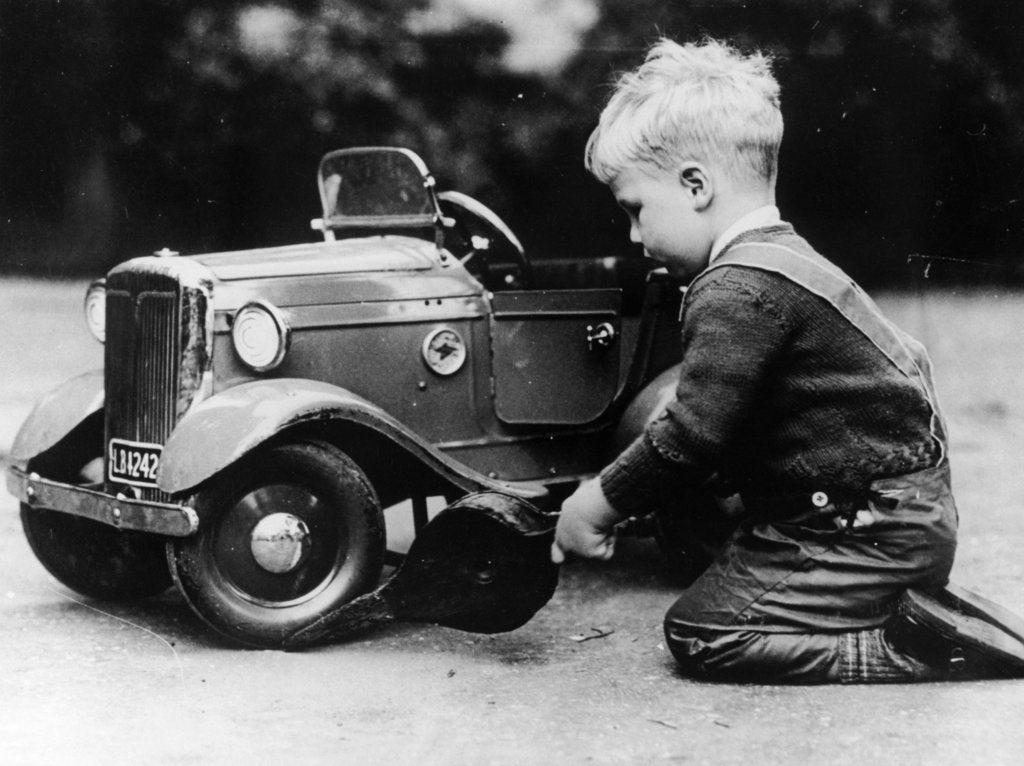 Detail of Michael Ware repairing a pedal car by Unknown