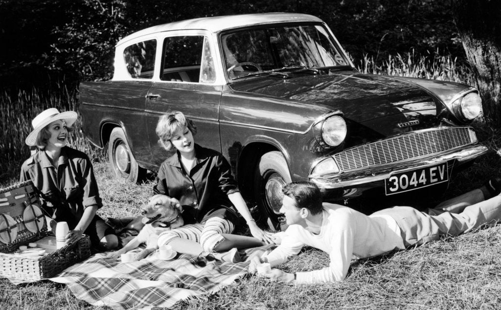 People picnicking with their 1960 Ford Anglia Deluxe, (1960?)