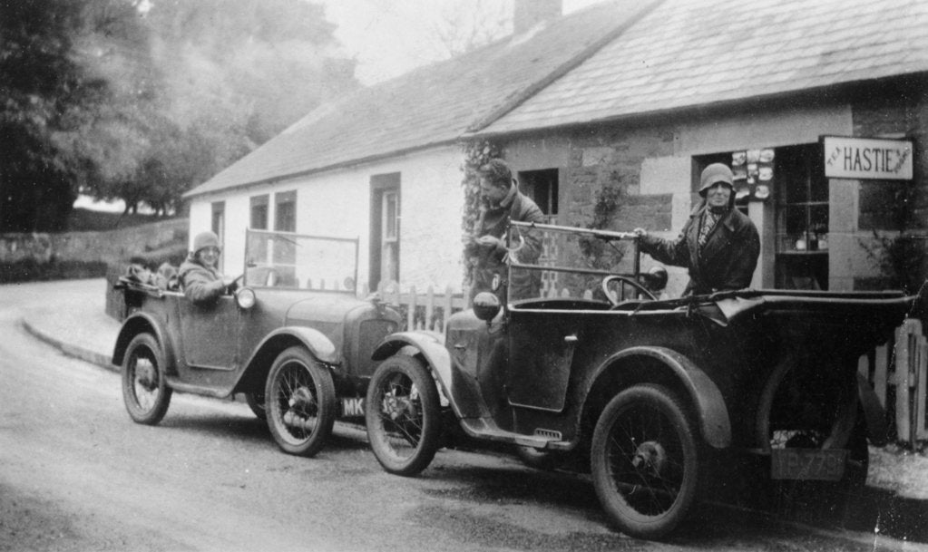 Two Austin Sevens parked outside a small tea shop, c1925