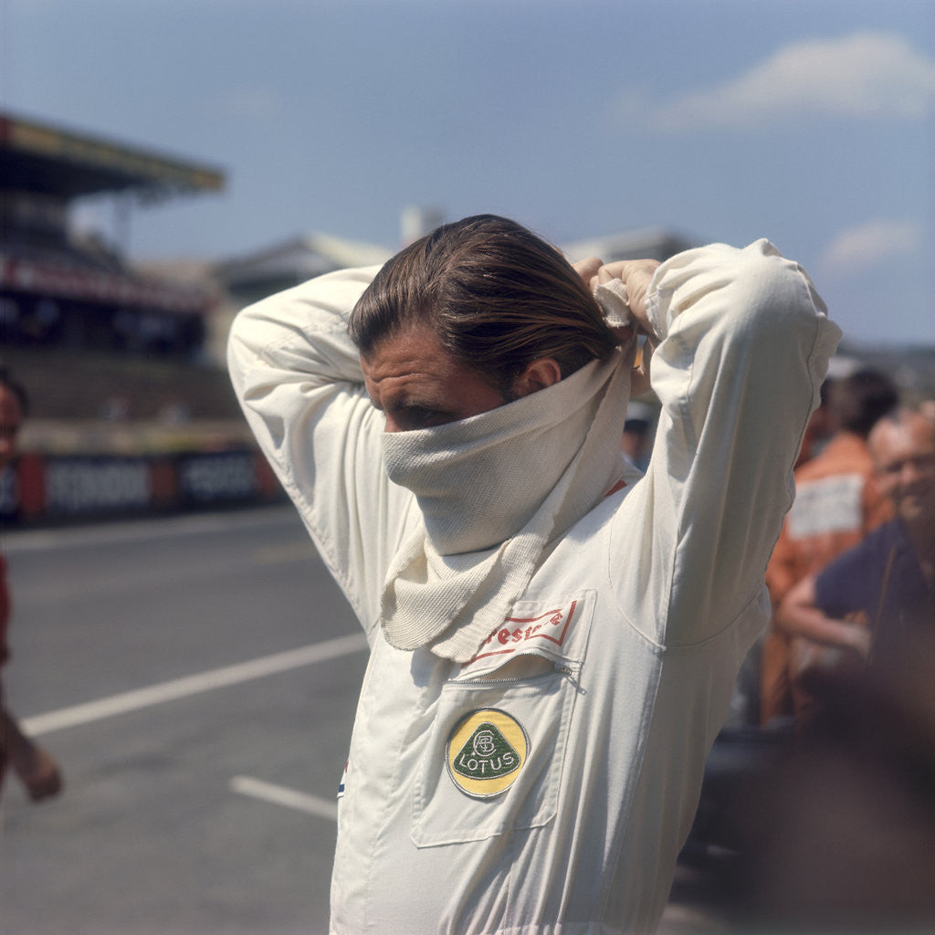 Graham Hill getting ready for the French Grand Prix by Anonymous