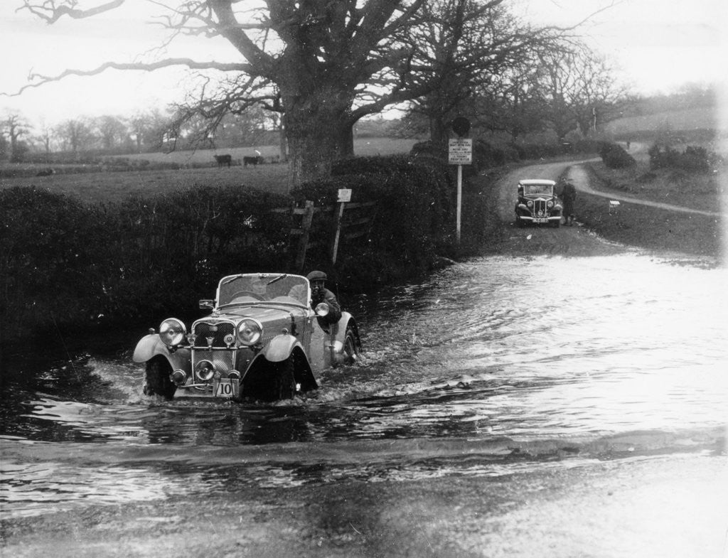 Detail of 1935 Singer 1.5 Litre Le Mans taking part in a water splash trial by Anonymous
