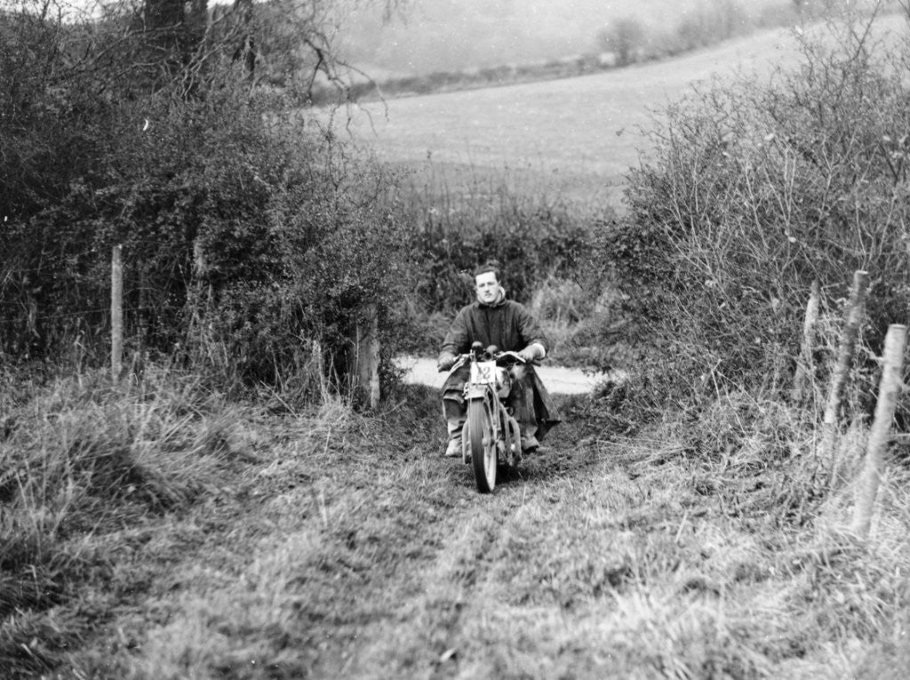 Detail of Syke riding an Ariel 4 during the Inter Varsity motor cross hill climb by Anonymous