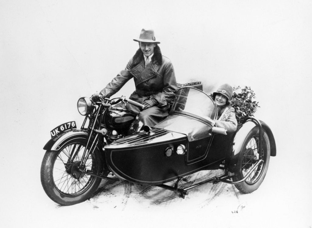 Detail of Man riding an AJS motorbike with a woman in the sidecar by Anonymous