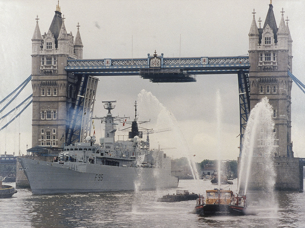 View of HMS London sailing beneath Tower Bridge, London by Anonymous