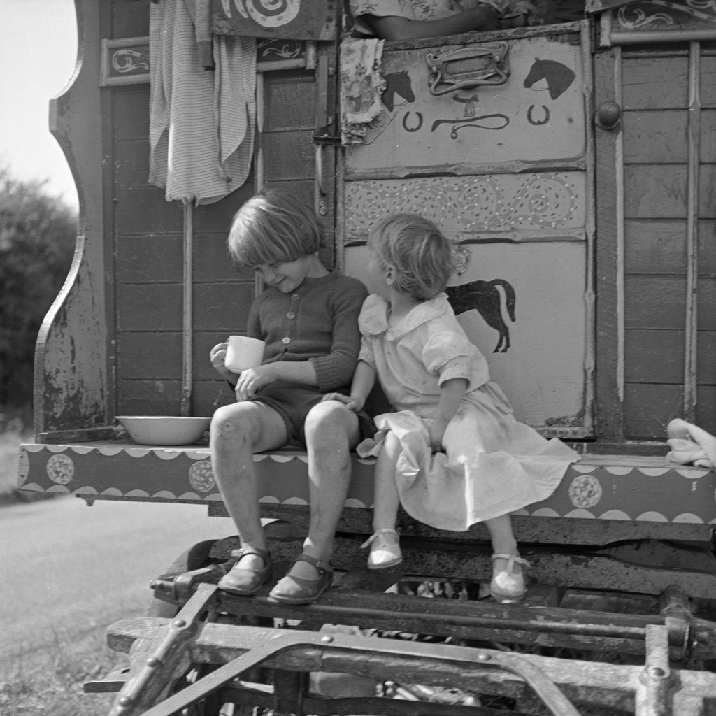 Detail of Children sitting on the steps of a gipsy caravan, Outwood, Surrey, 1963 by Tony Boxall