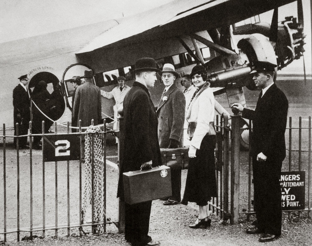 Detail of Ford Trimotor plane about to depart from an airfield by Anonymous