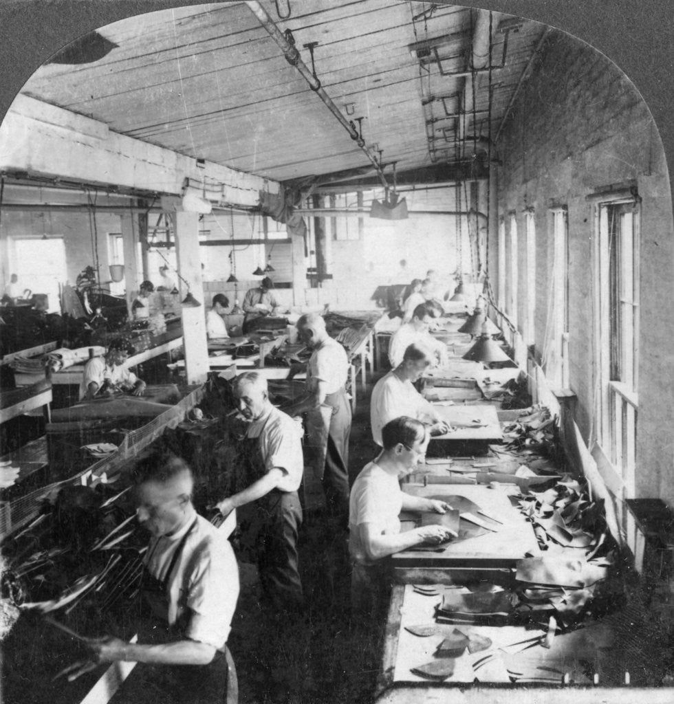 Detail of Workers cutting leather for shoes in a factory, Lynn, Massachusetts, USA by Keystone View Company