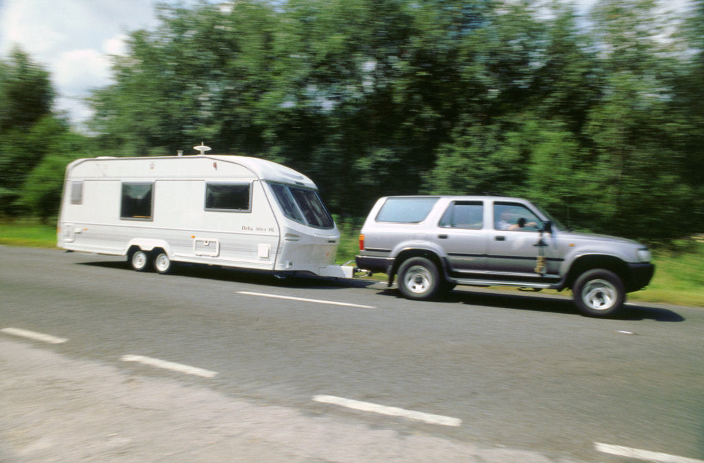 Detail of 1995 Toyota Landcruiser towing large caravan at speed by Unknown