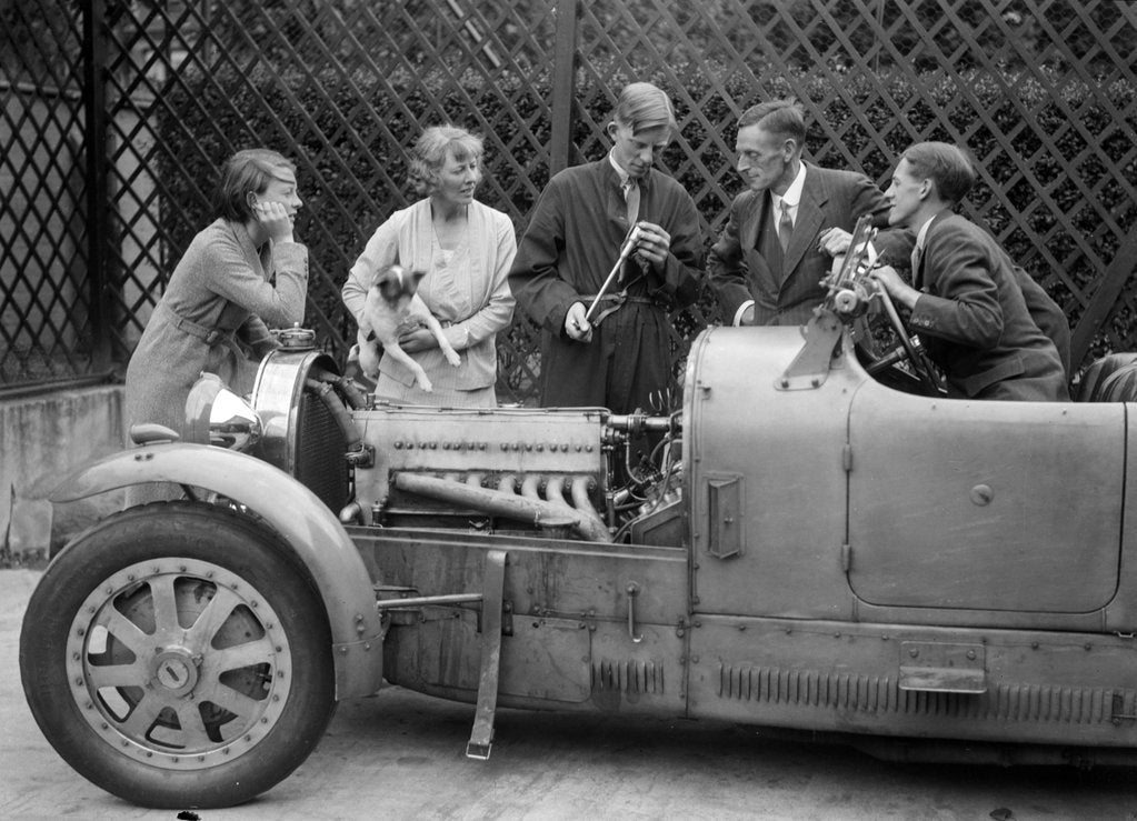 Detail of Denis Evans inspecting the plugs of his Bugatti Type 43 2262cc by Bill Brunell