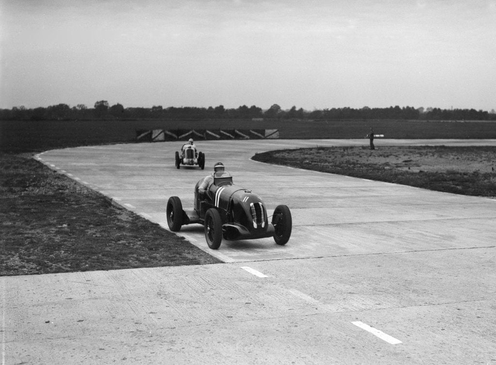 Detail of Rapier Special Racing single seater leading a MG in a race on the Campbell Circuit at Brooklands by Bill Brunell