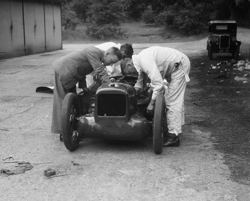 Detail of Mechanics working on Leon Cushman's Austin 7 racer for a speed record attempt, Brooklands, 1931 by Bill Brunell