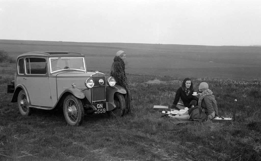 Three women having a picnic during a road test of a Triumph Scorpion, 1931 by Bill Brunell