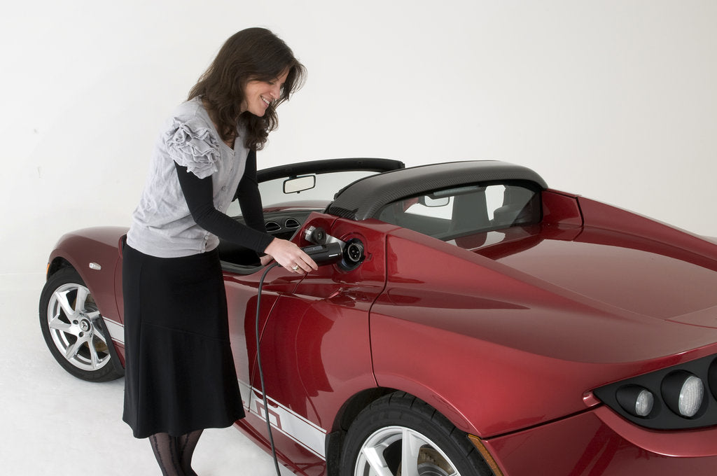 Detail of 2010 Tesla Roadster electric car being re charged by Unknown
