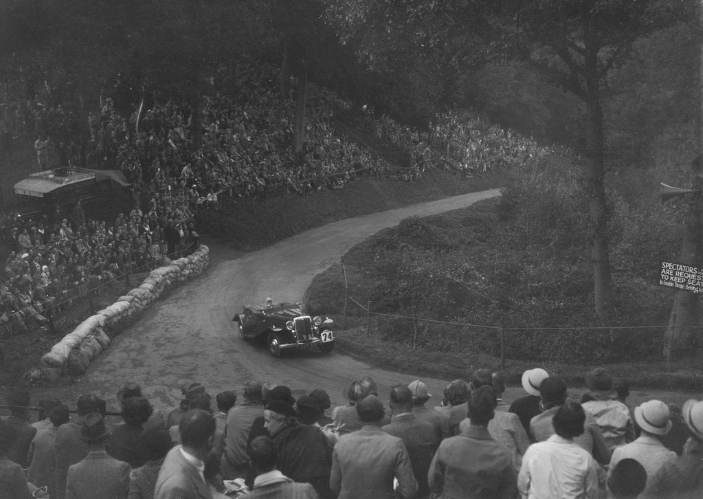 Detail of Unidentified open 4-seater car competing in the Shelsley Walsh Hillclimb, Worcestershire, 1935 by Bill Brunell