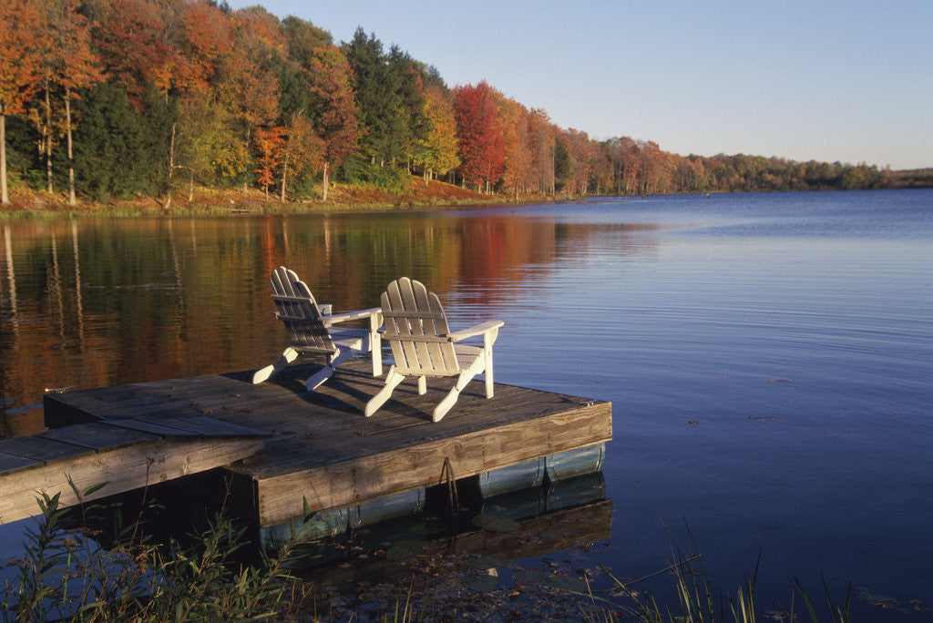 Detail of Adirondack Chairs on Dock at Lake by Corbis