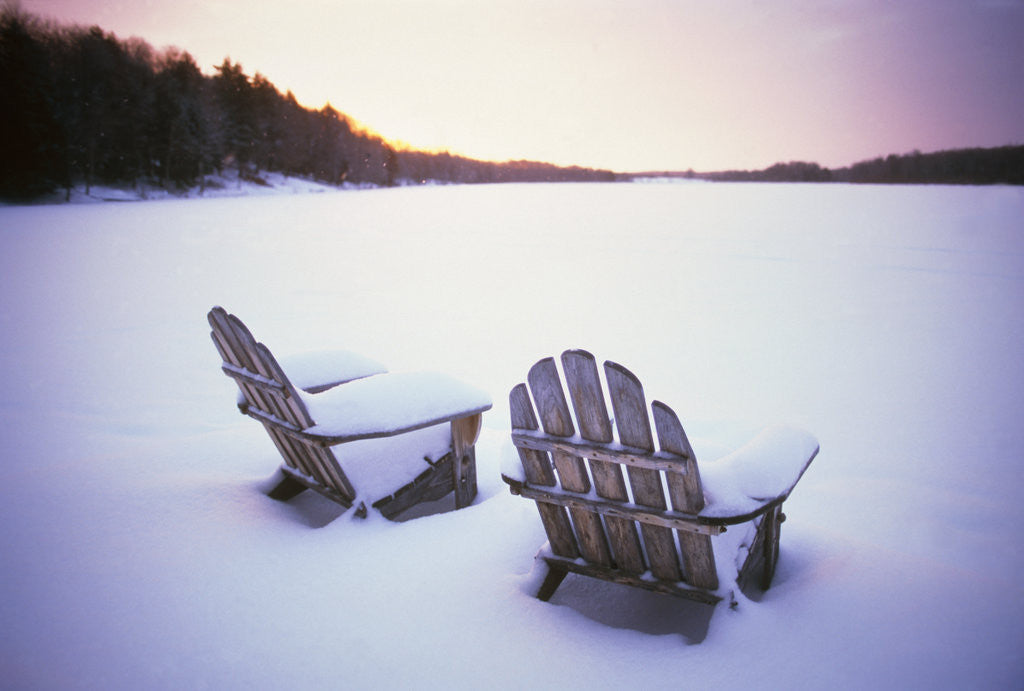 Detail of Two Snow-covered Chairs Outdoors by Corbis