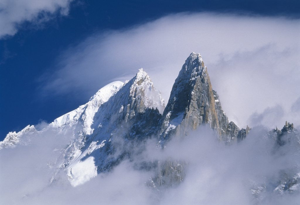 Detail of France, Alps, Mont Blanc Massif, Aiguille Verte, peak in clouds by Corbis