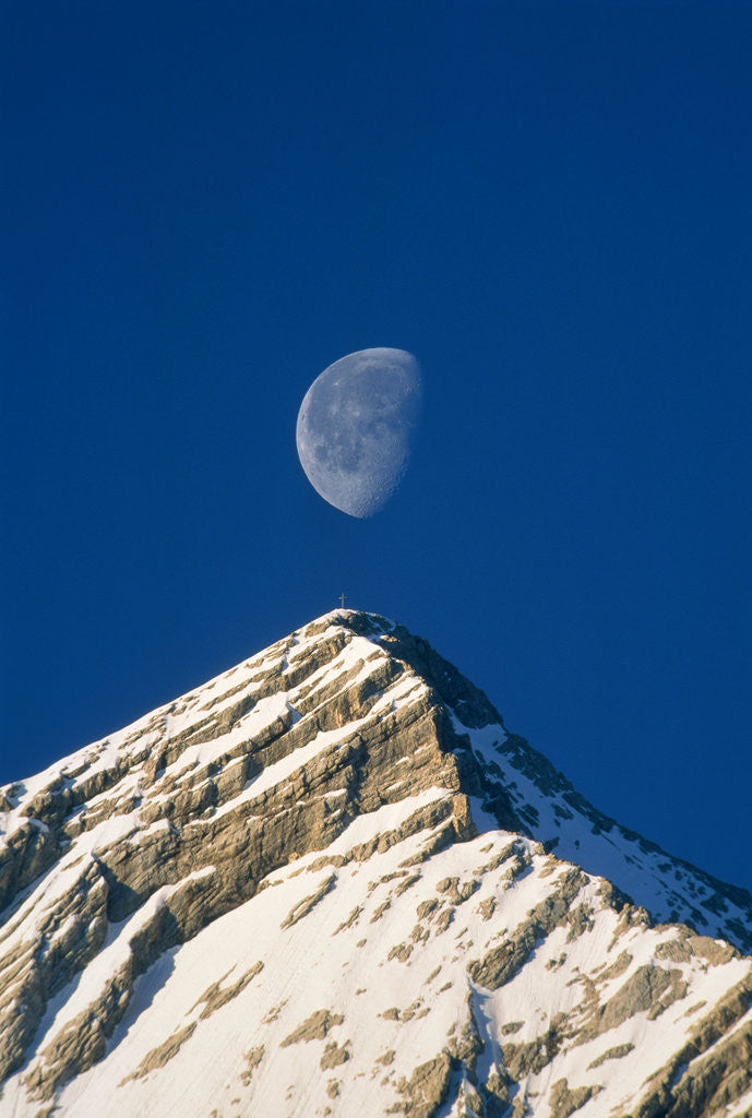 Detail of Europe, Alps, Wetterstein Mountains, Alpspitze, moon over peak by Corbis