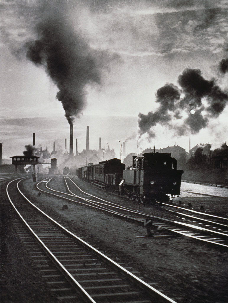 Detail of Freight train in front of smoking chimney stacks, nostalgia by Corbis