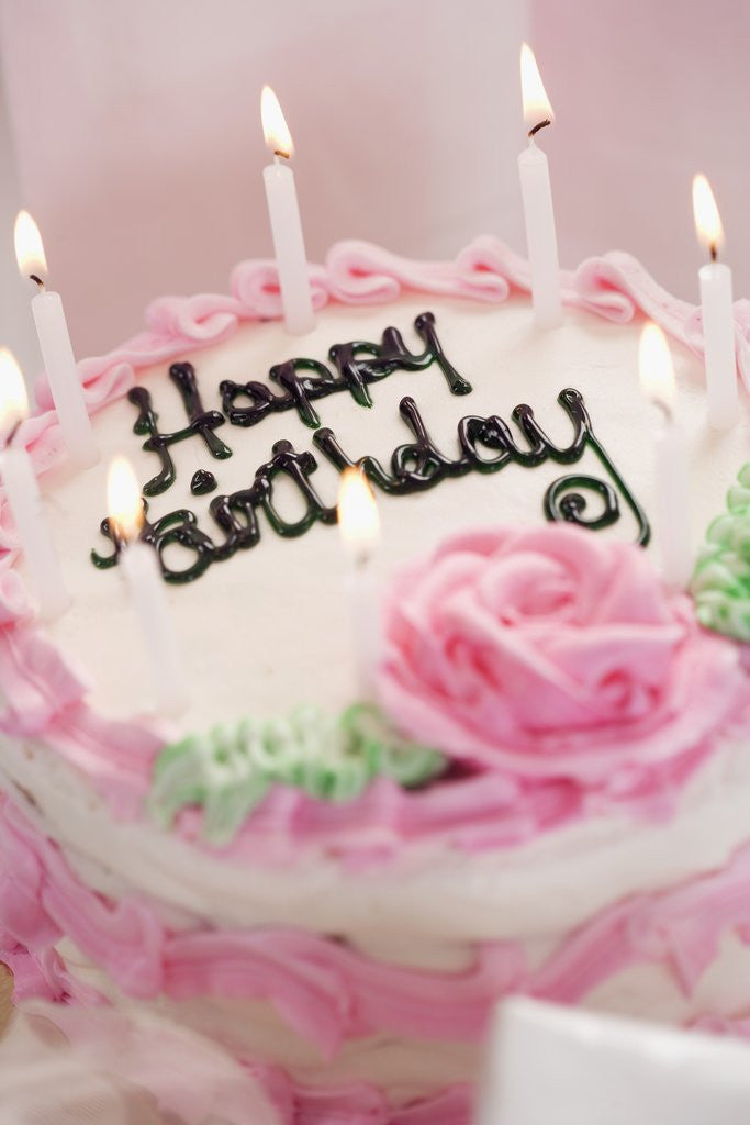 Detail of Birthday Cake With Lit Candles by Corbis