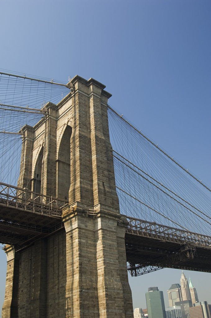 Detail of Brooklyn Bridge Tower and Lower Manhattan by Corbis