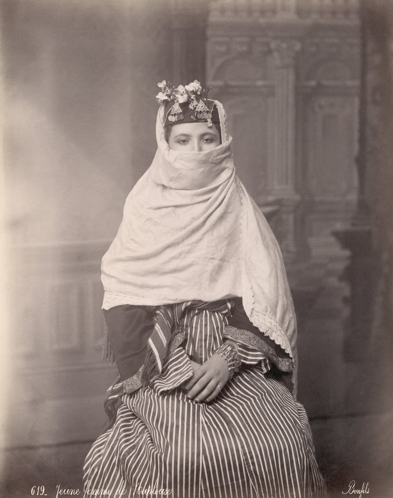 Detail of Young Woman in Traditional Middle Eastern Dress by Corbis