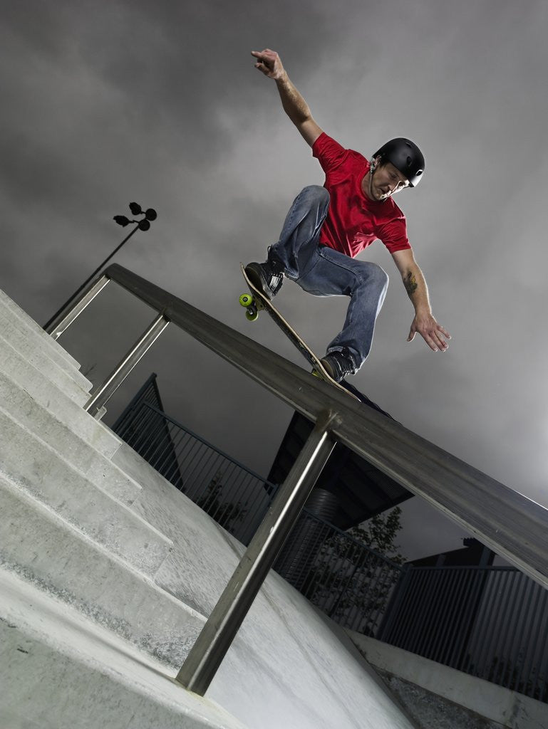 Detail of Skateboarder Performing Tricks by Corbis
