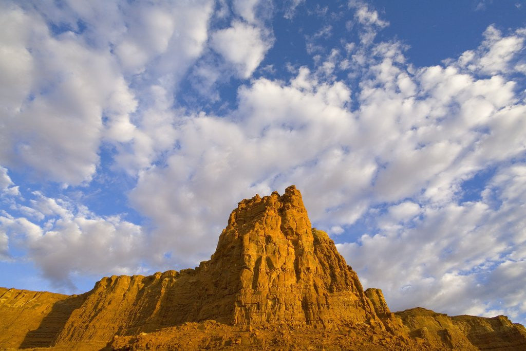Cumulus Clouds Over Sandstone Buttes at Sunrise by Corbis