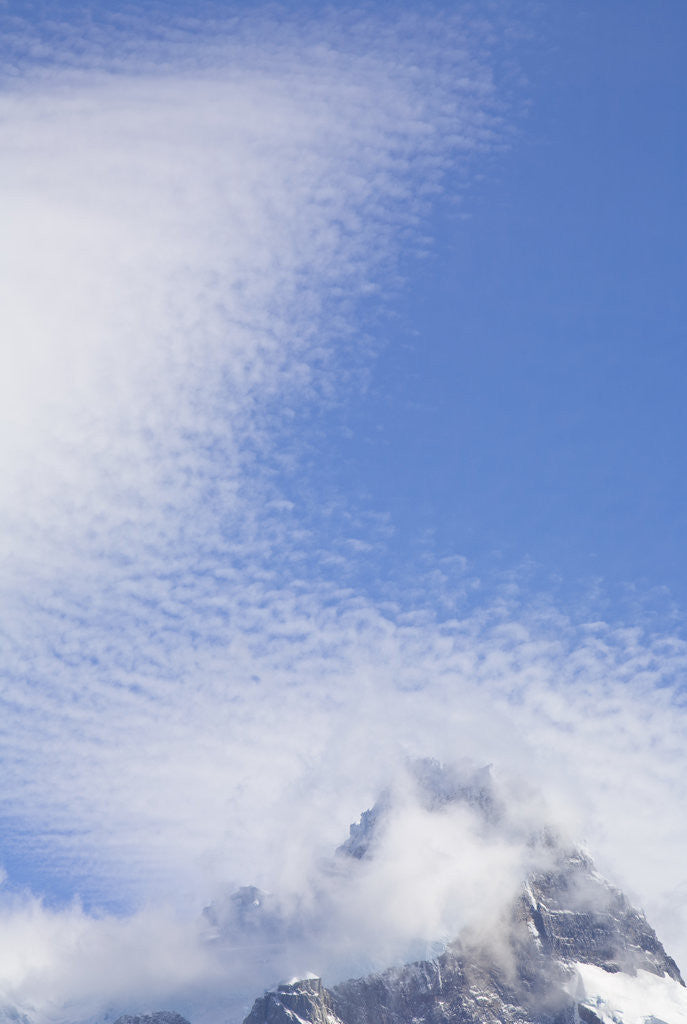 Detail of Cirrocumulus Clouds Above Rocky Crags by Corbis