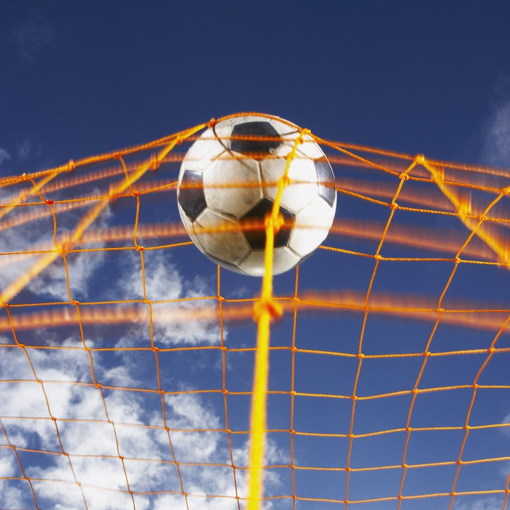 Detail of Soccer Ball Going Into Goal Net by Corbis