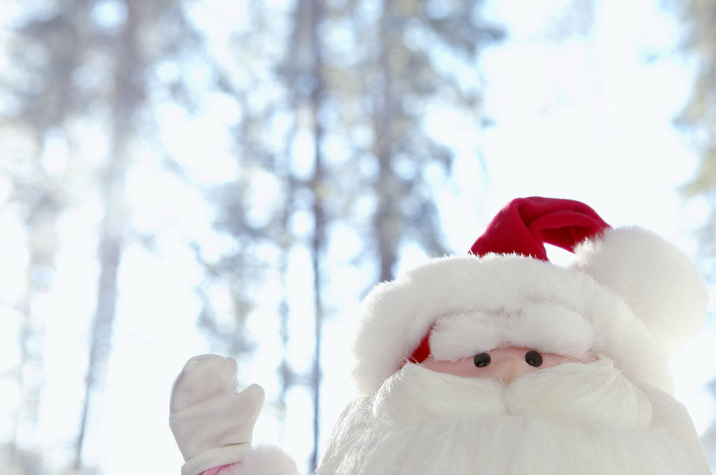 Detail of Santa Claus toy waving by Corbis