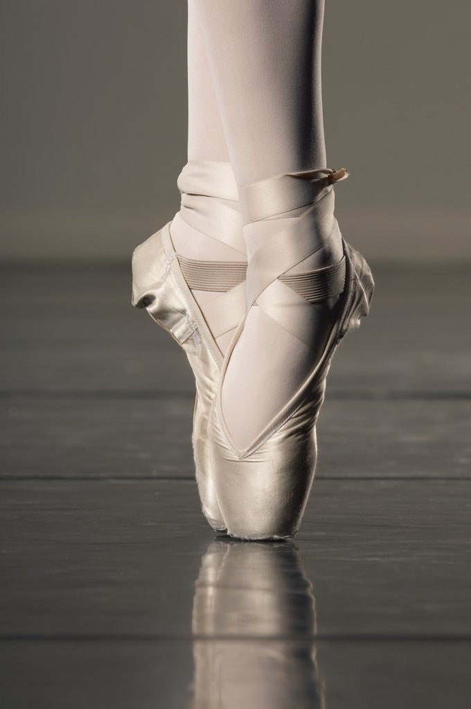 Detail of Feet of ballet dancer en pointe by Corbis