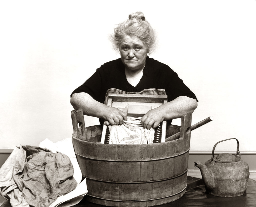 Detail of 1930s 1940s Senior Woman Washing Clothes In Old Fashioned Wooden Tub And Washboard by Corbis