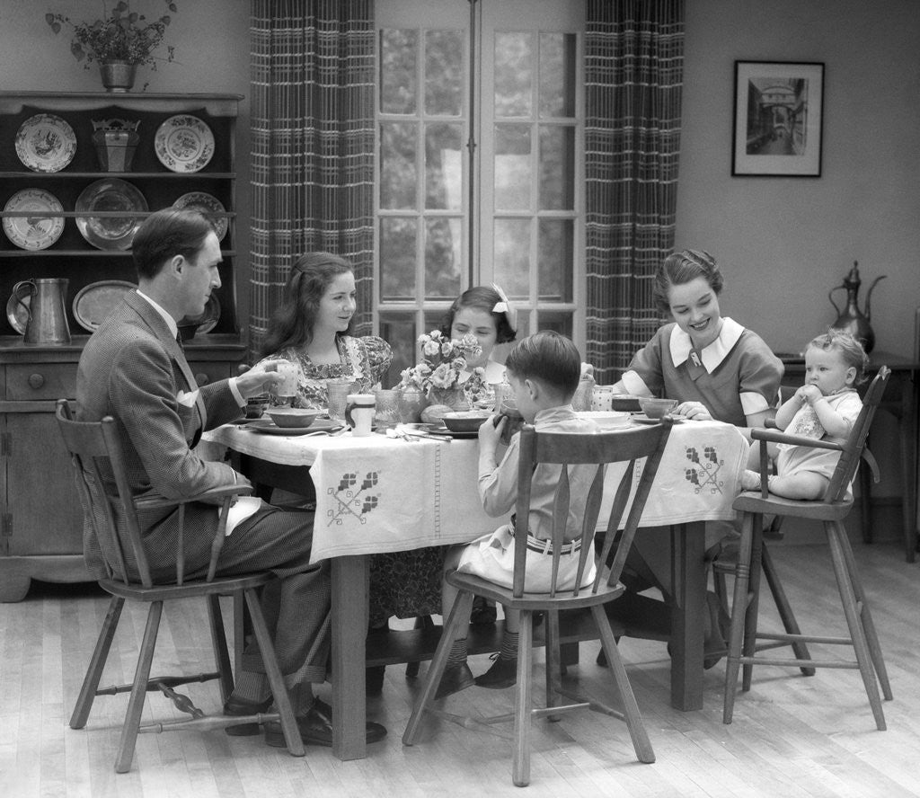 Detail Of 1930s Family Of 6 Sitting At The Table In A Dining Room Eating  Breakfast