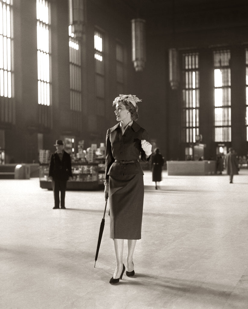 Detail of 1950s Fashionable High Class Woman Alone Train Station Umbrella Waiting Lonely by Corbis