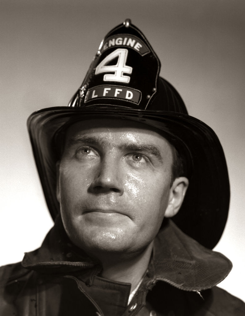 Detail of 1950s Portrait Fireman Serious Expression Metal Fire Hard Hat Engine 4 by Corbis